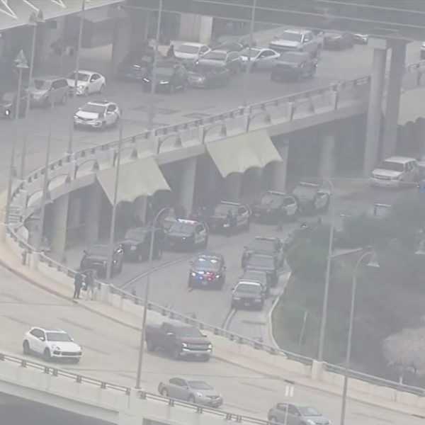 The San Antonio International Airport went into a lockdown Thursday afternoon after a man opened fire near a terminal roadway. Police shot and killed him. (WOAI PHOTO FROM LIVE FEED)