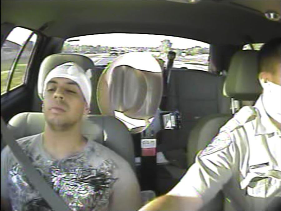 Alan Dieguez, an El Paso Police officer at the time, is driven to jail from a Round Rock hospital by a Texas trooper hours after a deadly crash on Interstate 35. Dieguez suffered a cut to his head. (Texas Department of Public Safety in-car camera Photo)