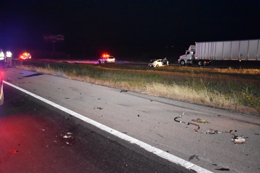 This crash scene photograph taken by a Texas DPS investigator and obtained by KXAN through an open records request shows part of the debris field left when Alan Dieguez's Hyundai slammed into the back of an 18-wheeler at 100 miles an hour. Dieguez's car eventually stopped on the I-35 frontage road. (Texas Department of Public Safety Photo)
