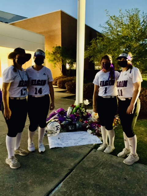 Elgin High softball players on Monday night honored the memories of Willie Simmons III and Alyssa Broderick with some flowers, after they were killed along with Alyssa's mother in a northwest Austin shooting over the weekend. (Pictured: #17 Camryn Davis, freshman; #14 Cassady Davis, junior; #1 Emma Neidig, senior; #11 Hailey Girod, junior)
