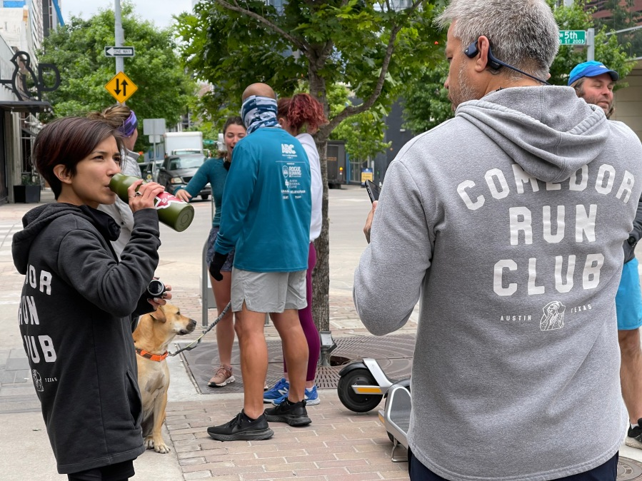 Anna Mendoza speaks to Philip Speer as they prepare to go on a run with Comedor Run Club. (KXAN Photo/Chelsea Moreno)