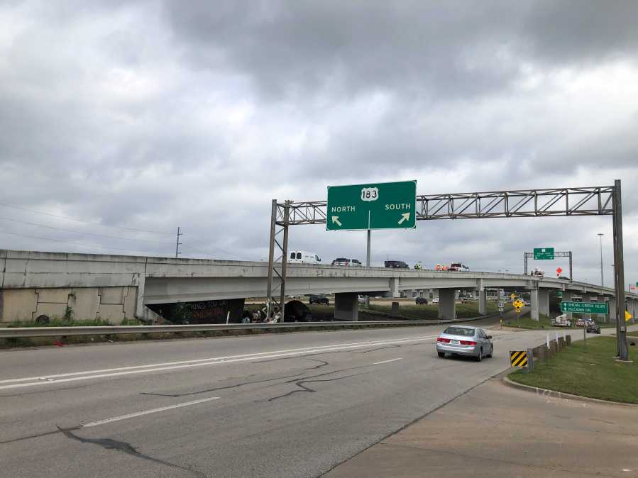 A deadly crash involving a TxDOT truck led to the closure of the northbound US 183 flyover to MoPac southbound Wednesday. (KXAN photo/Julie Karam)