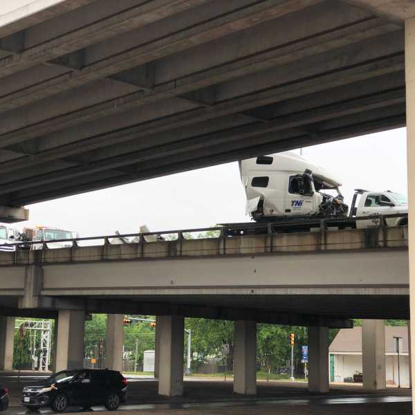 A semi-truck crashed and closed the lower deck of I-35 Thursday morning. The truck was leaking diesel fuel on to the road. (KXAN photo/Julie Karam)