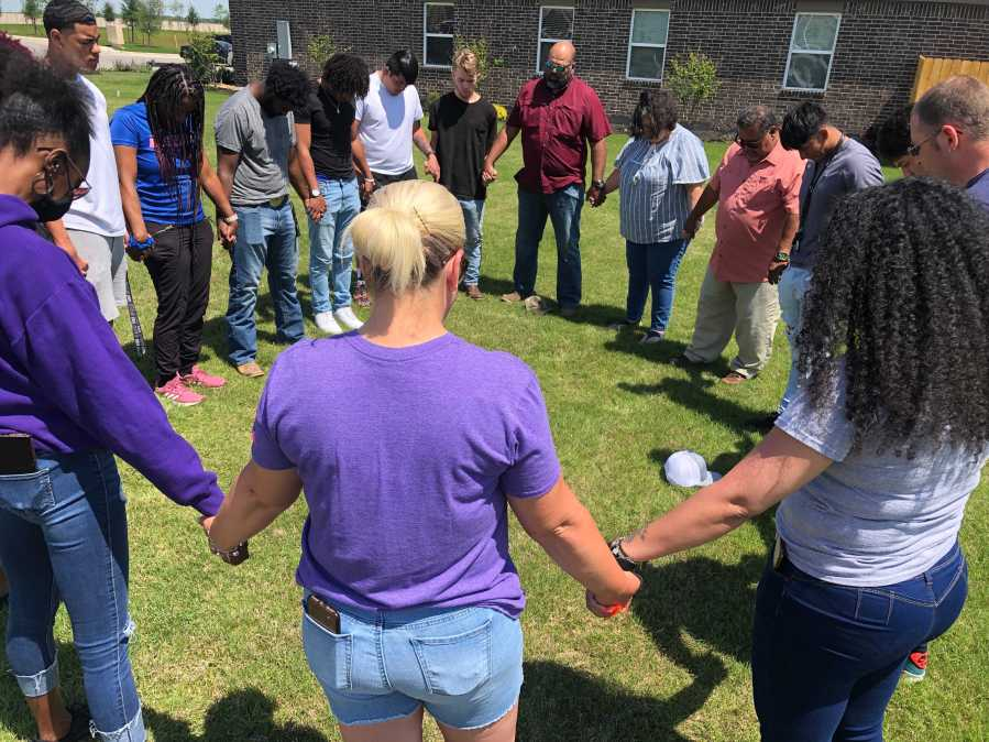Members of the Elgin community come together to remember Willie Simmons III, Alyssa and Amanda Broderick, the victims in a triple homicide in northwest Austin. (KXAN Photo/Frank Martinez)