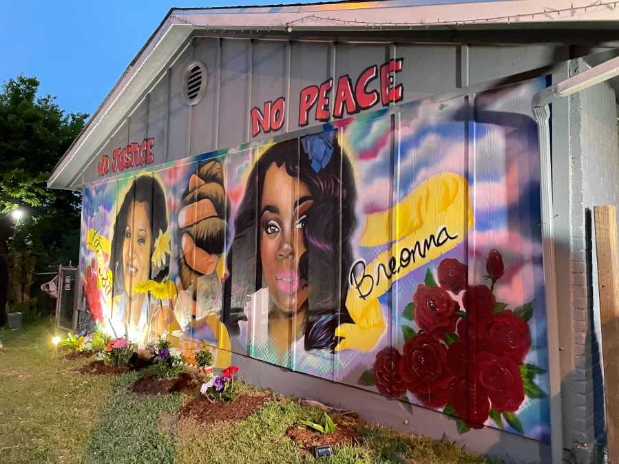 Vigil held at Vanessa Guillén's mural in southeast Austin one year after her disappearance. (KXAN/Tim Holcomb)