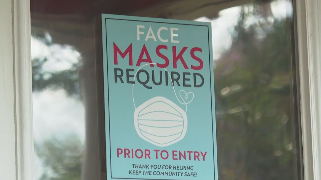Face Masks Required sign outside of a business (KXAN File Photo)