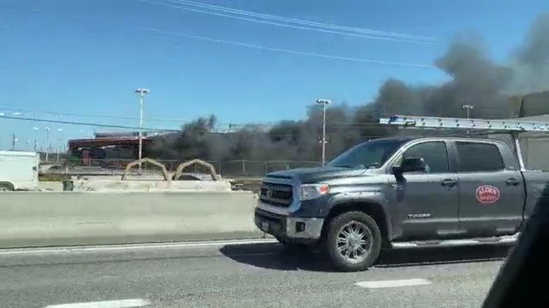 Structure fire as seen from the highway off Blackson Avenue and I-35 service road northbound May 6, 2021 (KXAN Photo/Nick Bannin)