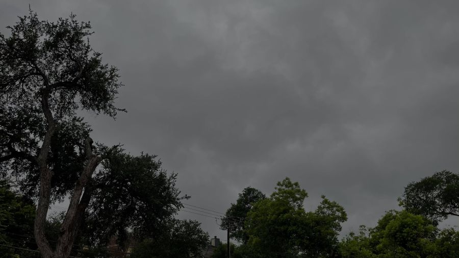 An under-exposed (too dark) photo of clouds overhead in downtown Austin (KXAN Photo)