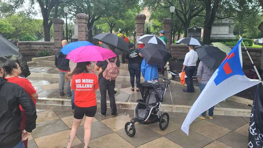 Group opposed to the death penalty gathers outside Governor's Mansion Tuesday (KXAN Photo/Andrew Choat)