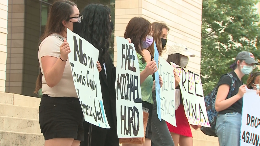 Protestors rallied at Republic Square Park Wednesday evening demanding charges be dropped against activists who were arrested during the Black Lives Matter protests last summer. (KXAN Photo/Tim Holcomb)