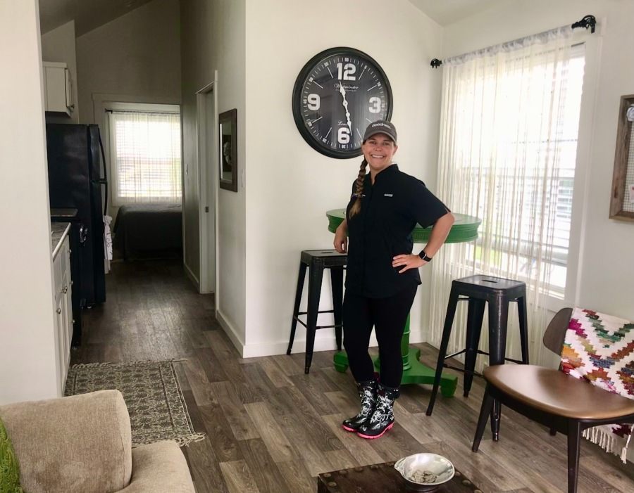 Mobile Loaves & Fishes President Amber Fogarty visits one of the site's tiny homes. The Community First! Village houses those who were previously experiencing homelessness. (Kelsey Thompson/KXAN)