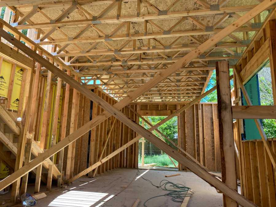 One of Smith's homes in the framing stage. The HBA said lumber prices won't be going down anytime soon, partly because it will take more than 20 years to re-grow forests lost to wildfires last year. (KXAN Photo/Tahera Rahman)
