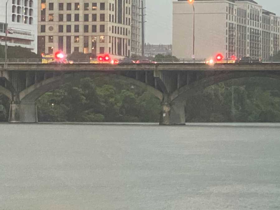 Water rescue of paddle boarder during severe storm on Congress Avenue (KXAN/Todd Bynum)