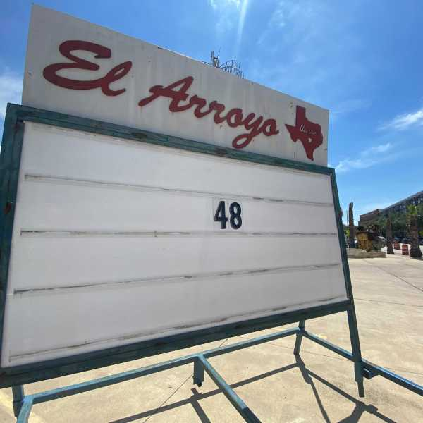 El Arroyo honors Jake Ehlinger by displaying his jersey numbers on its famous marquee (KXAN Photo/Todd Bynum)