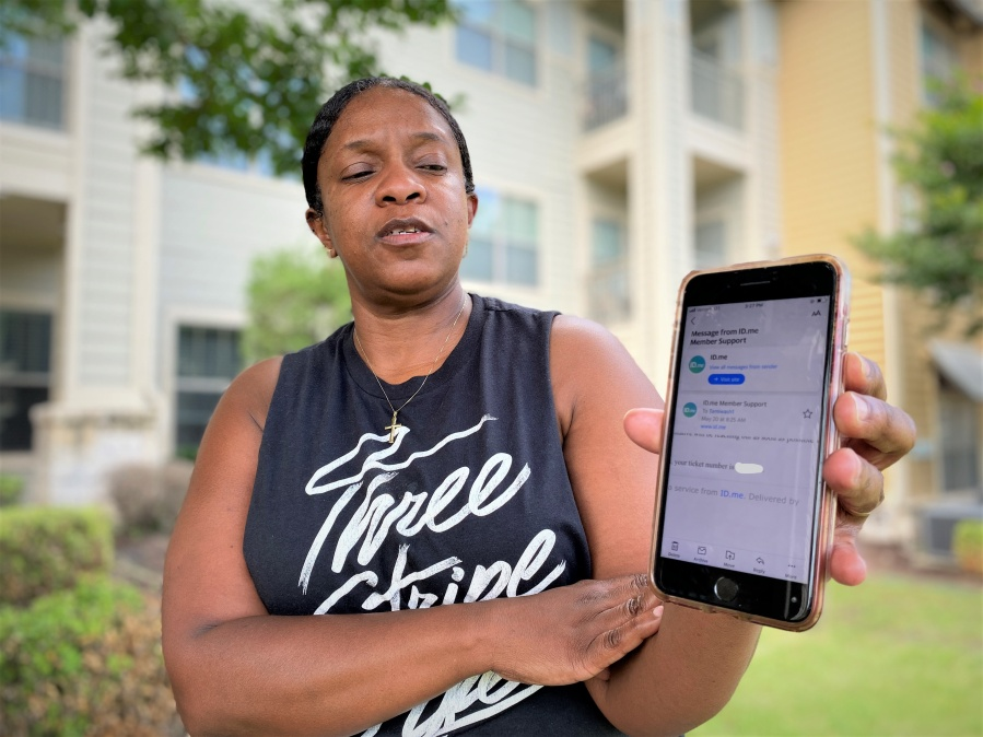 Tammy Coleman shows the only communication she's received since submitting identity verification records to ID.me, the private company the Texas Workforce Commission hired to verify identities of claims suspected of being fraudulent. (KXAN Photo/Jody Barr)