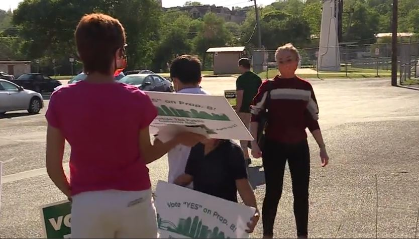 """Save Austin Now volunteers greet voters during early voting. """"It's amazing the diversity of the people who are very nervous about this,"""" one volunteer told us during the campaign (KXAN Photo/Chris Nelson)"""