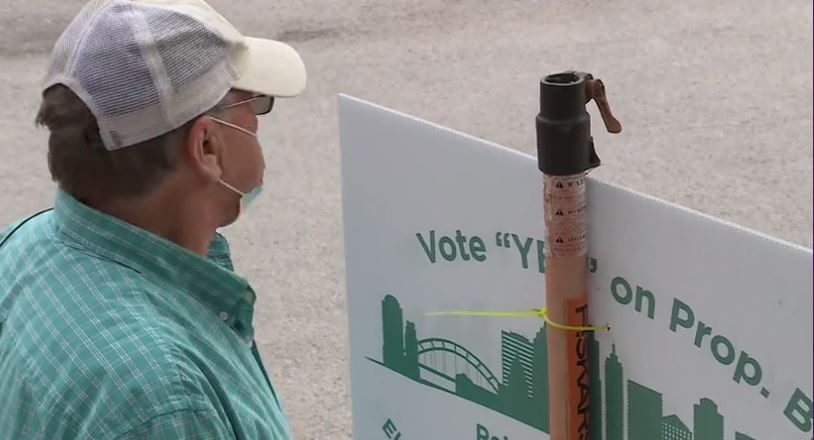 A Save Austin Now volunteer greets voters during early voting. Political experts tell us all Austin voters want to solve the city's homeless problem, but there are big differences that have galvanized support (KXAN Photo/Chris Nelson)