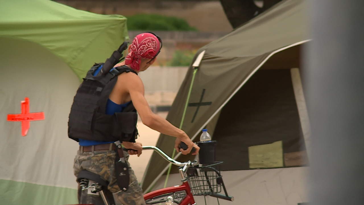 Homeless campers around City Hall form their own armed 'security detail'
