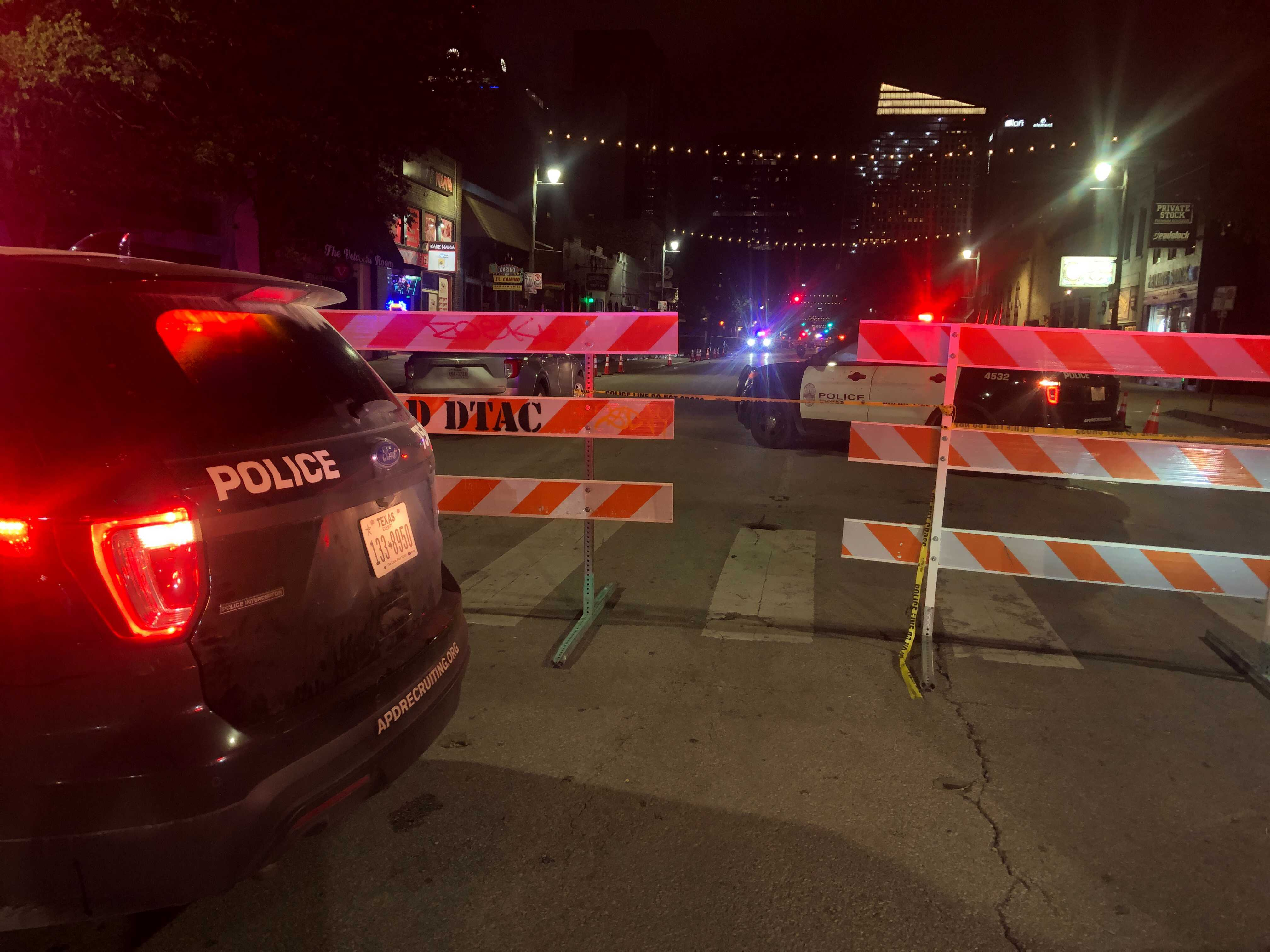 At least 14 people are hurt after a mass shooting in downtown Austin on 6th Street near Trinity Street June 12, 2021 (KXAN Photo)