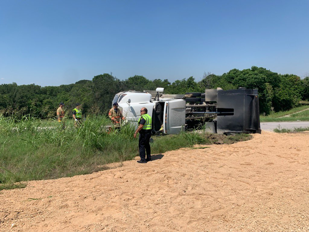 A dump truck rolled over on the I-35 frontage road in Round Rock June 16, 2021 (Round Rock Police Department Photo)