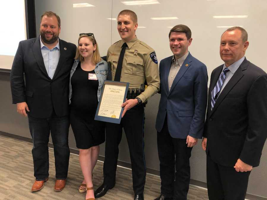 """Williamson County deputy Jonathan Hudash received the Carnegie Medal for his act of """"extraordinary heroism"""" following an April 2020 car crash where he pulled a man out of a burning van. (KXAN photo/Frank Martinez)"""