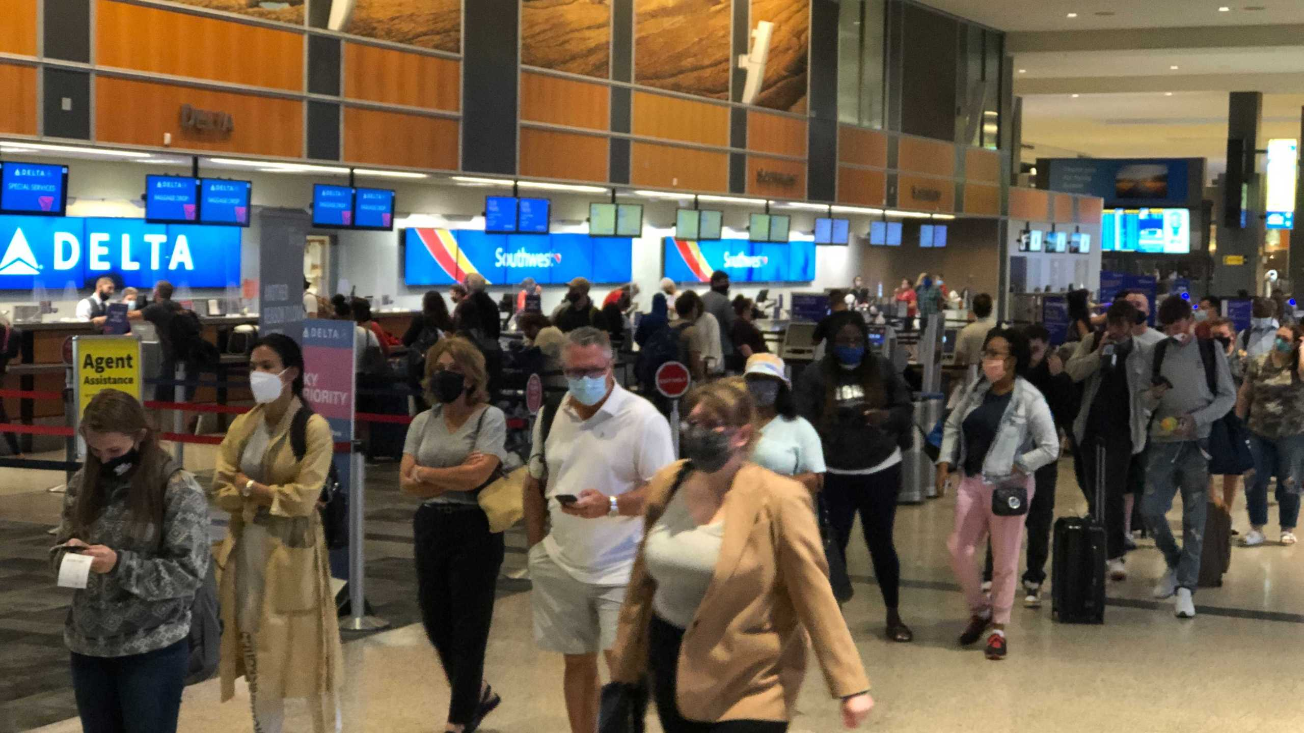 Austin-Bergstrom International Airport was busy again Friday morning as travelers rushed to catch flights. (KXAN photo/Julie Karam)