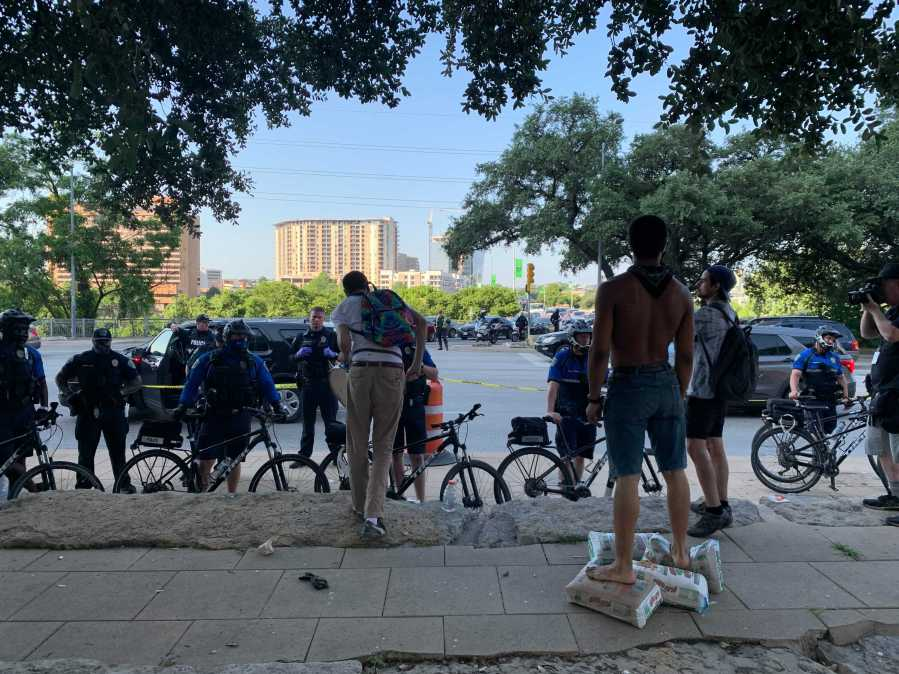 Austin police officers and other city employees are clearing out homeless encampments around City Hall on Monday. (KXAN photo/Andy Way)