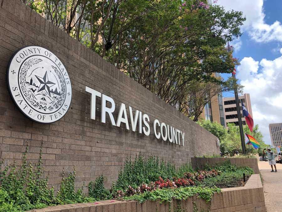 Pride flag-raising ceremony at Travis County building