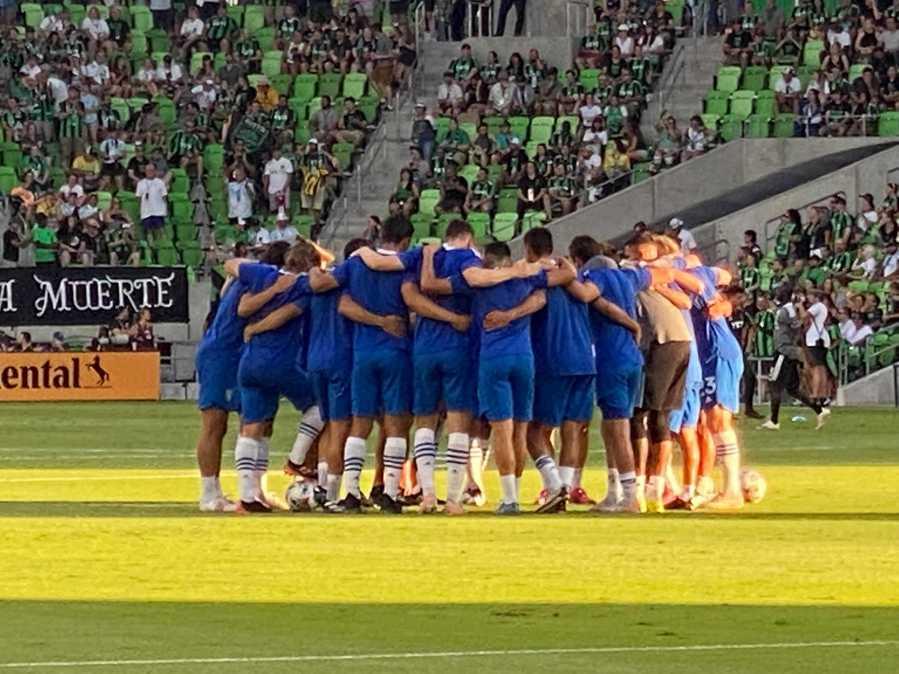 The San Jose Earthquakes huddle on the pitch at Q2 Stadium (KXAN Photo)