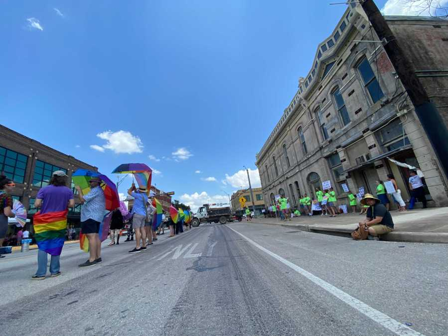 Parasol Patrol volunteers help to shield kids and attendees of Taylor's inaugural Pride event from protesters against the event June 26, 2021 (KXAN Photo/Tahera Rahman)