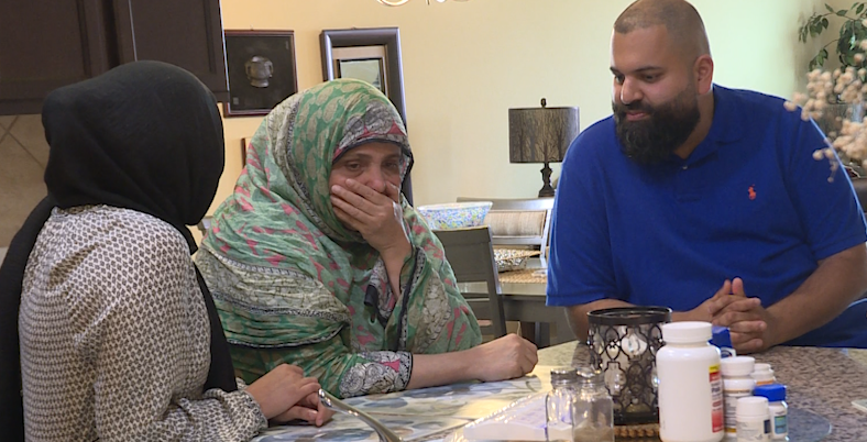 The Nomani family works to calm their nerves. To say they're stunned doesn't even do justice to what they're feeling. (KXAN Photo/Jala Washington)