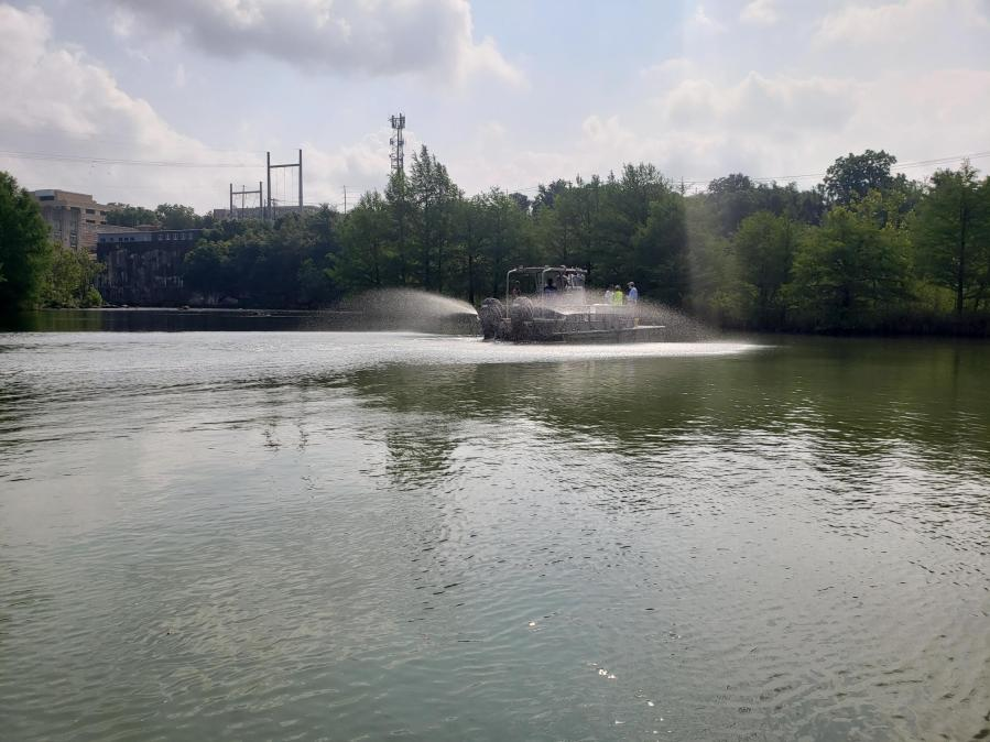 Applying Phoslock to Lady Bird Lake near Red Bud as part of the Harmful Algae Pilot Program (Watershed Protection Department Photo)