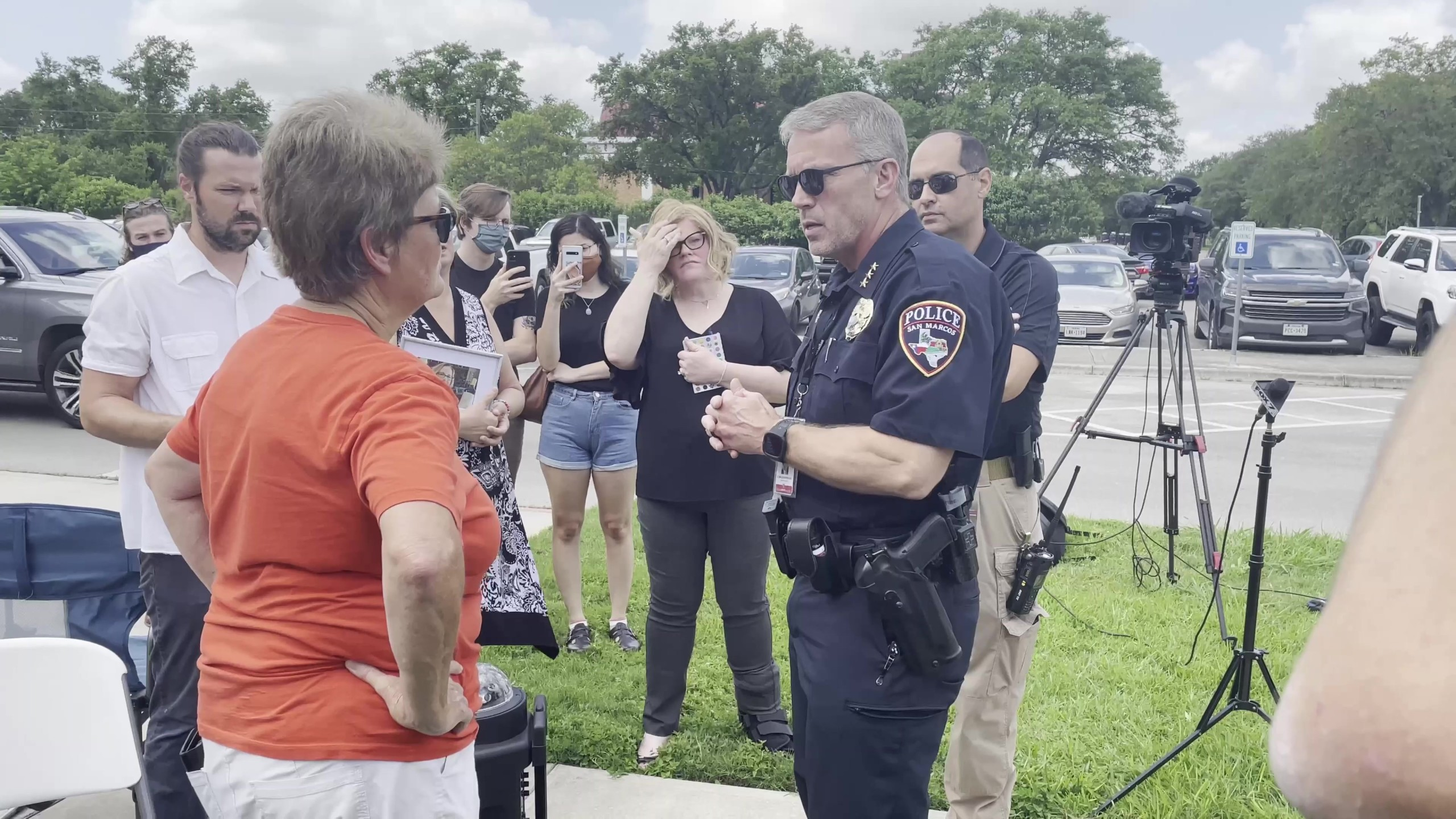 Pamela Watts, survivor of a crash caused by an off-duty San Marcos police officer that killed her partner, confronts San Marcos Police Chief Stan Standridge on how the case was handled and why the officer was allowed to return to work for the department. (KXAN Photo/Jala Washington)