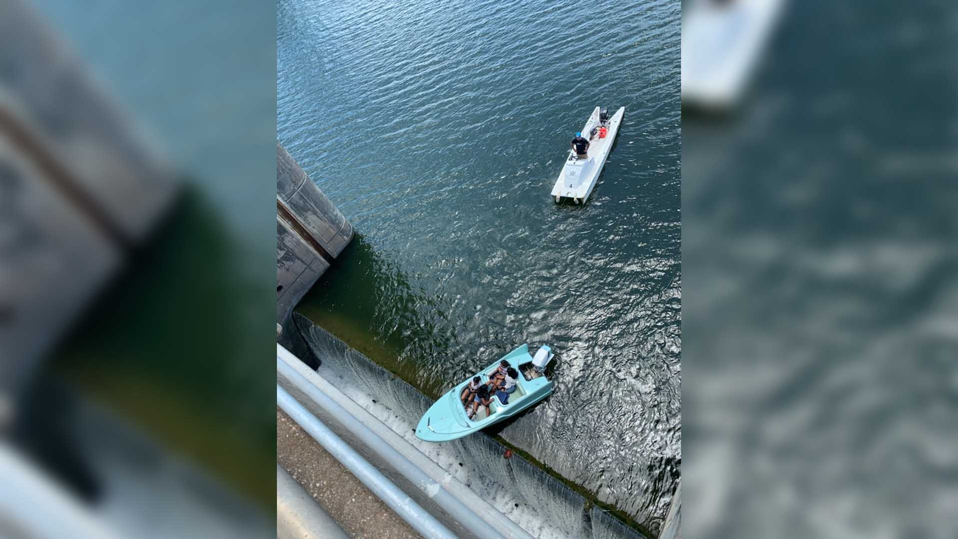 Four people rescued from boat about to go over Longhorn Dam June 10, 2021 (ATCEMS Photo)
