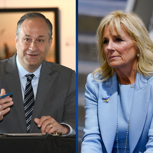 LEFT: Doug Emhoff speaks during a roundtable discussion with local restaurant owners at the Annapolis Maritime Museum and Park on May 18, 2021.(Paul W. Gillespie/The Baltimore Sun via AP) RIGHT: First Lady Jill Biden listens as President Joe Biden speaks at Sportrock Climbing Centers on May 28, 2021, in Alexandria, Va. (AP Photo/Evan Vucci)