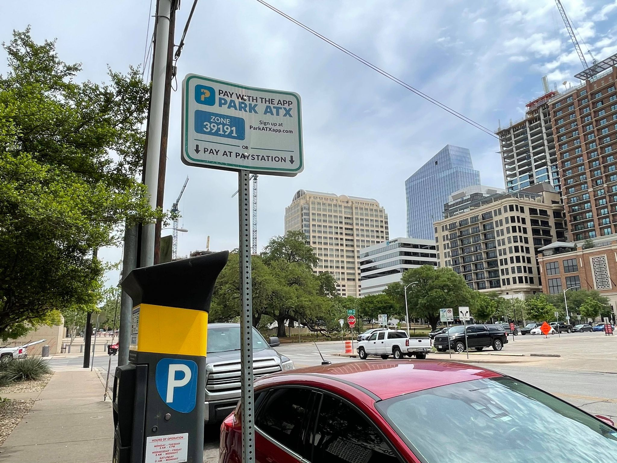 A parking meter and zone sign in downtown Austin (KXAN Photo/Jaclyn Ramkissoon)