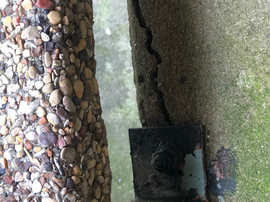 Cracked concrete at a staircase at Denise Mahoney's Austin apartment complex. (Courtesy Denise Mahoney)