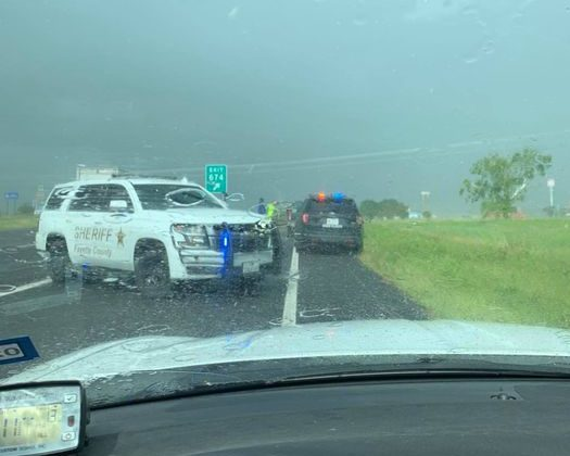 Law enforcement blocks off the road after a reported chase