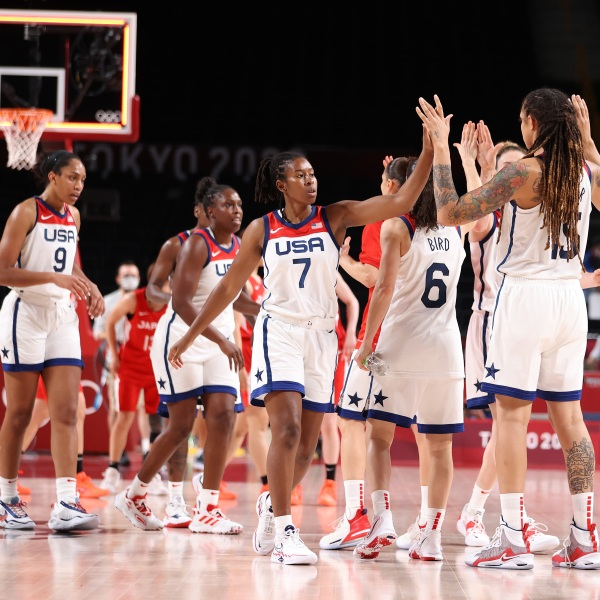 SAITAMA, JAPAN - JULY 30: Ariel Atkins #7 of Team United States celebrates a win against Japan with teammates following a Women's Basketball Preliminary Round Group B game on day seven of the Tokyo 2020 Olympic Games at Saitama Super Arena on July 30, 2021 in Saitama, Japan. (Photo by Gregory Shamus/Getty Images)