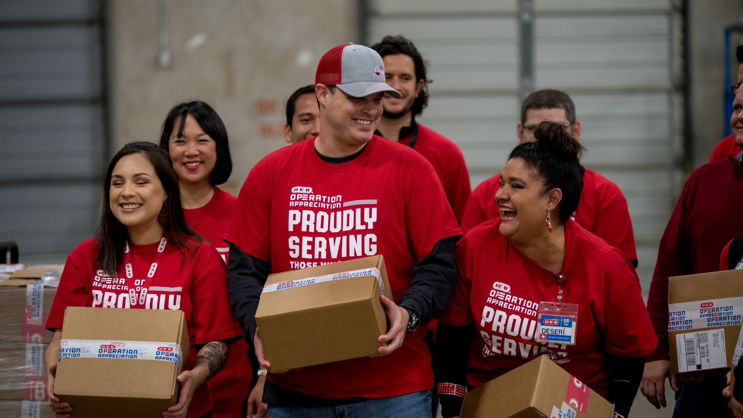 H-E-B employees carry boxes for Operation Appreciation