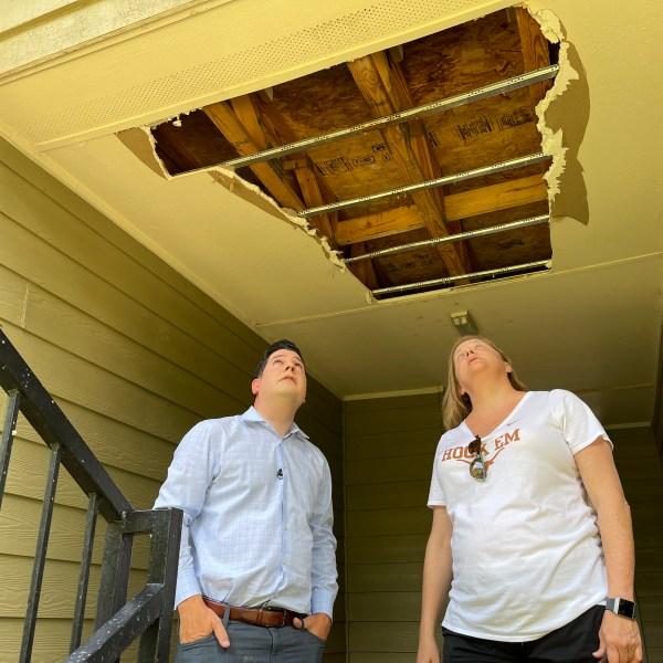 Denise Mahoney shows KXAN investigative reporter Matt Grant ceiling damage at her Austin apartment complex.(KXAN Photo/Ben Friberg)