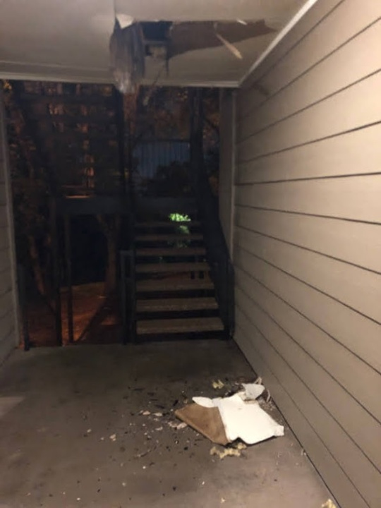 Photo showing a ceiling giving way, apparently after water damage (Courtesy Denise Mahoney)