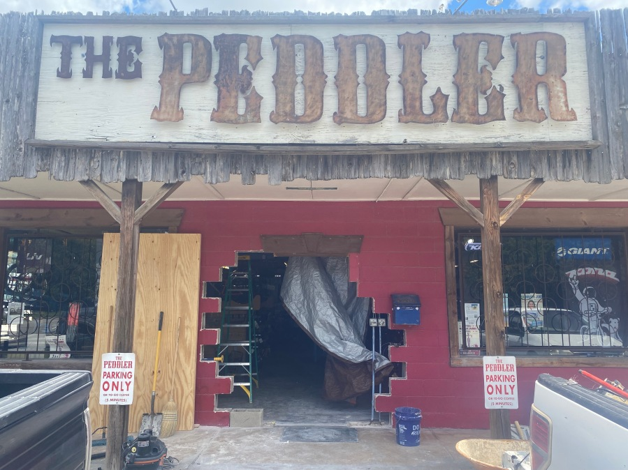 A gaping hole in the side of The Peddler bike shop in Austin was left by thieves stealing bikes. (KXAN photo/Richie Bowes)