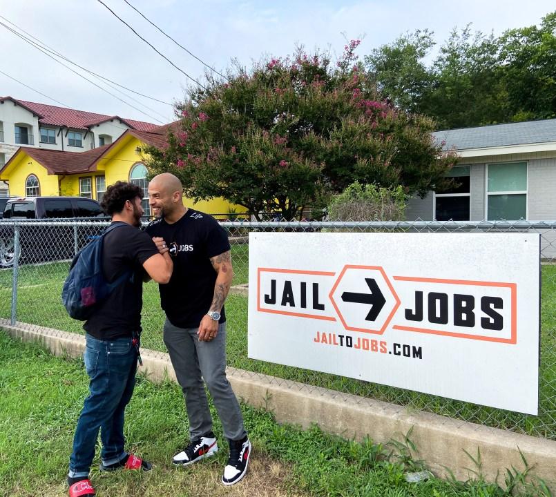 Antonio Martinez, left, and Jeremias Cooper outside the Travis County location. (KXAN Photo/Clare O'Connor)