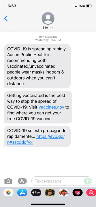 A text message from Austin Public Health on Friday urges people to mask up and get their vaccines. (KXAN Photo/Tahera Rahman)