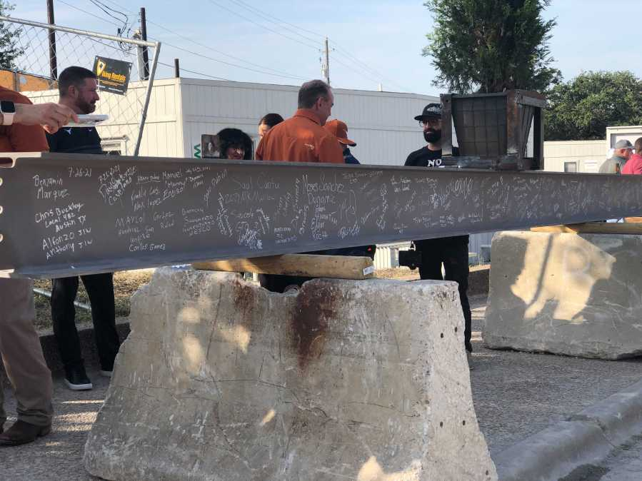 The final beam was placed in the frame of the Moody Center in a ceremony Tuesday. (KXAN photo/Julie Karam)