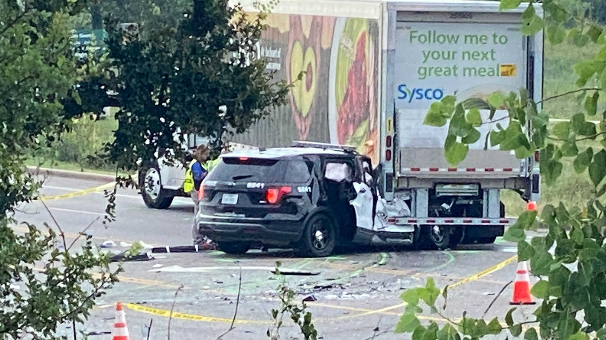 An APD officer is in the hospital after a crash on FM 969 near Decker Lane on Wednesday morning. (KXAN photo/Nabil Remadna)