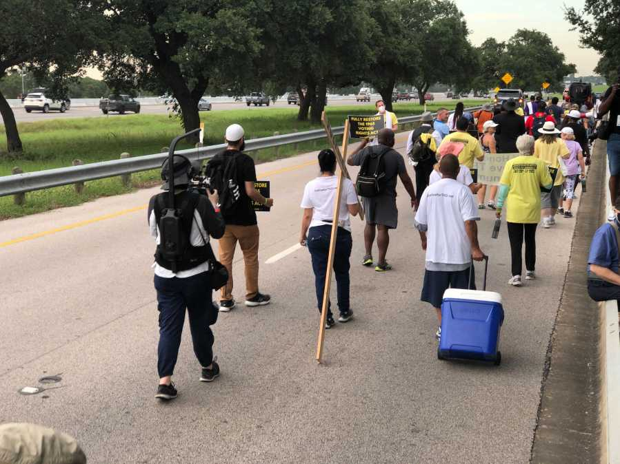 Voting right activists are walking 27 miles from Georgetown to the Texas Capitol building to fight Republican-backed voting law changes currently being discussed in the legislative special session. (KXAN photo/Julie Karam)