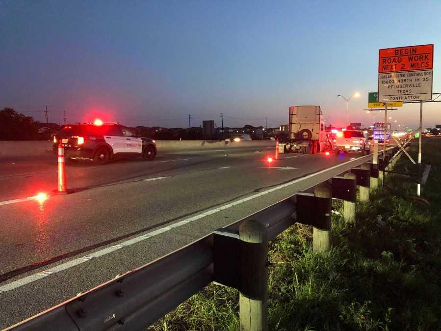 A crash involving an 18-wheeler closed I-35 northbound near Grand Avenue Parkway on Thursday morning. (KXAN photo/Julie Karam)