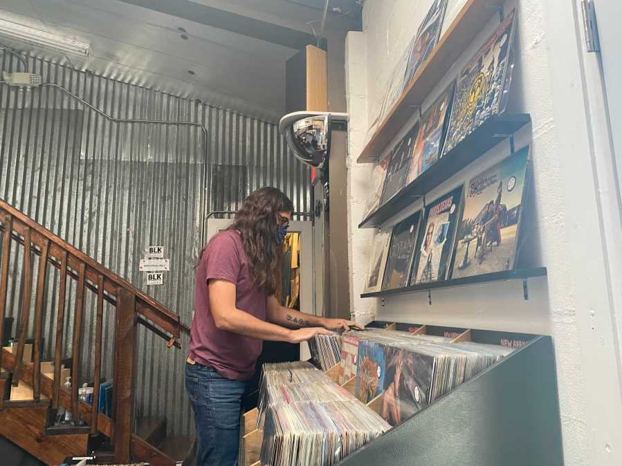 Lough says employees have been wearing masks at BLK Vinyl, but they've been giving customers the choice. He says most have been wearing them. That may soon change with new APH guidelines, he says. (KXAN Photo/Tahera Rahman)